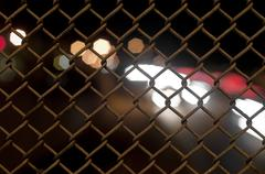 chain fence with a bokeh blur in the background - stock photo