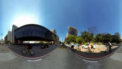People and cyclists stroll along Avenida Paulista near the Museum of Art MASP Stock Footage