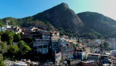 Majestic aerial favela rise and reveal of mountain setting in Rio de Janeiro Stock Footage