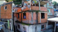 Favela aerials: Rising through houses in Vidigal Stock Footage