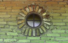 circular window with brickwork on an old building. photo taken in the mission - stock photo