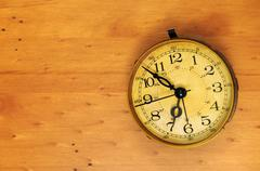 An old classic antique vintage pocket watch on a wooden background with backg Kuvituskuvat