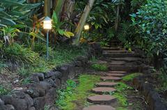 red hexagon pathway stones in a beautiful garden walkway - stock photo