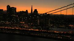 Aerials USA San Francisco Oakland Bay Bridge sunset city - stock footage