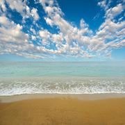 a clean clear bright beach in hawaii. photograph taken in the day. - stock photo