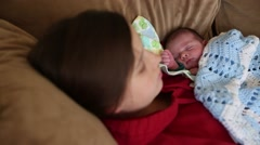 Mother taking nap with a newborn baby boy Stock Footage