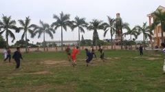 Asian young people playing football Stock Footage