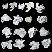 crumbled up paper isolated on black background. - stock photo