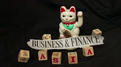 "LUCKY ASIAN CAT - Static slow motion shot ""Business"" in Asia Stock Footage"