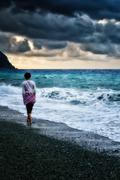 girl walking by the sea - stock photo