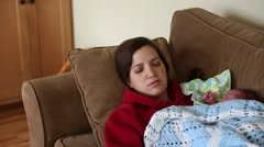 A mother taking nap with newborn Stock Footage