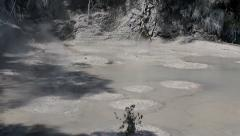 Boiling volcanic mud pool Stock Footage