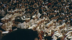 Tokyo 1964: orchestra at the olympic stadium - stock footage