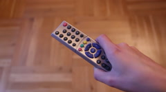 Switching the TV control and hitting it because it does not work. Stock Footage