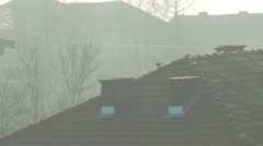 Roof of the building and moorning fog. - stock footage