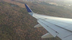 Airplane Wing, Clouds, Flying Jet Aircraft - stock footage