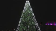 Close tilt outdoor christmas tree - night Stock Footage