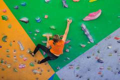 Indoor climbing girl Stock Photos