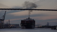Industrial pollution as container ship leaves port of savannah at sunset, ga, Stock Footage