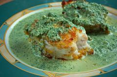 Merluza en salsa verde Stock Photos