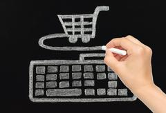 hand drawing with chalk keyboard connected to cart. - stock photo