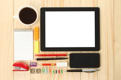 Tablet pc and smart phone with school office supplies. Stock Photos