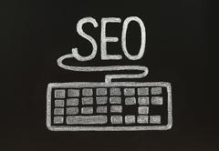 Chalk seo concept with keyboard. Stock Photos