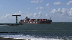 Container ship Hanjin Phoenix inbound + beacon Maasmond, Port of Rotterdam Stock Footage