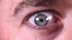 Intense terrified eye close up, blue male eye, scared, angry emotions - stock footage