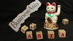 "LUCKY ASIAN CAT - Slow motion dolly ""Business Asia"" Stock Footage"