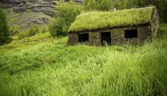 Ruins of a sod roof house Stock Photos