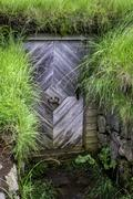 A door to an old turf house - stock photo