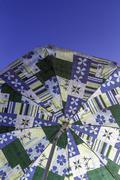 Umbrella and blue sky Stock Photos