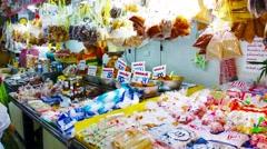 Patong, phuket, thailand - circa nov 2014: local vendor weighing and bagging Stock Footage