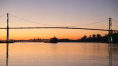 Sunrise Freighter Under Lions Gate Bridge - stock footage