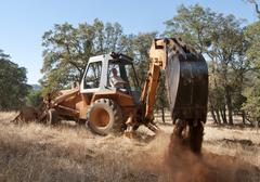 Backhoe out in the field Stock Photos
