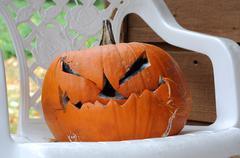 Scary rotting halloween pumpkin jack-o-lantern Stock Photos