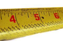 Macro closeup of a yellow measuring tape. Stock Photos