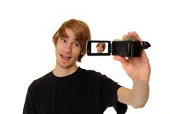 man with hd camcorder - stock photo