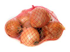 onions isolated on white in a fishnet. - stock photo