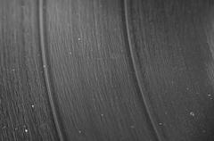 A macro closeup of an lp record with dust in the grooves Stock Photos