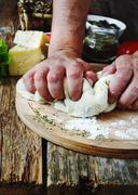 Human hand knead pizza dough Stock Photos