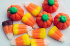 A pile of halloween candy corn on a white background. Stock Photos