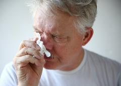 Senior man with runny nose Stock Photos