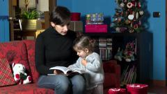 Mom Reading Book To Child During Xmas Holidays At Home Stock Footage