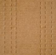 Flat brown cardboard  background texture with perforated lines that will help Stock Photos