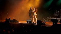 Salsa dancer dances on stage Stock Footage