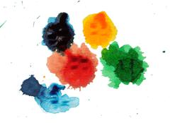 Abstract closeup photograph of colorful ink and paint splotches, splatters, d Stock Photos