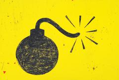 bomb drawn in with a thick black marker on a yellow background. - stock photo