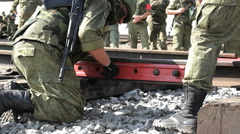 Russian Soldiers are connecting rail of railway. Stock Footage